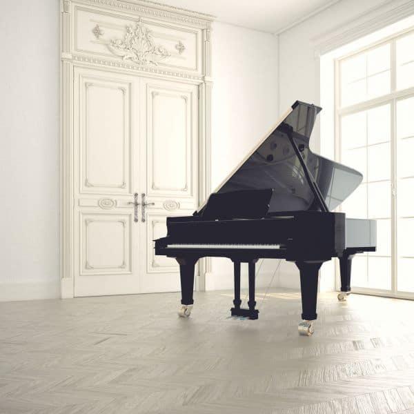 a big black piano on a white room